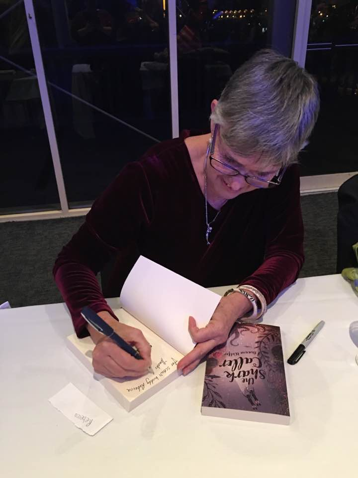 Dianne Wolfer signing books at the launch of The Shark Caller at AQWA 2016 (Photograph by Rebecca Laffar-Smith)