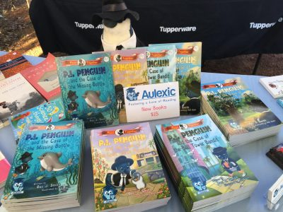P.I. Penguin watching over the P.I. Penguin books at Bedfordale Bush Markets